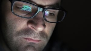 man gambling reflection in glasses