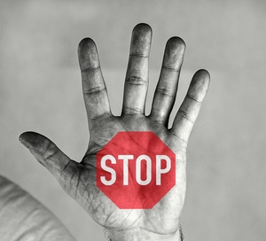 stop sign on a hand