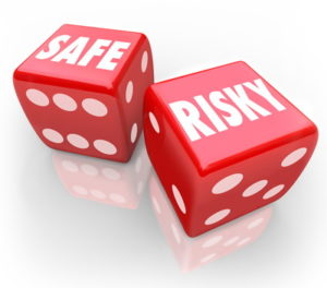 safe risky written on dice